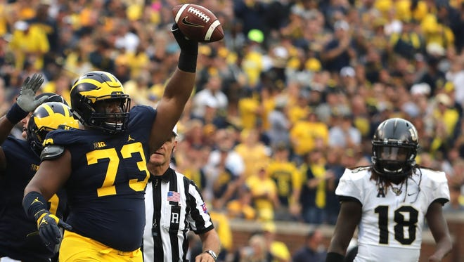 Michigan Wolverines' Maurice Hurst celebrates his fumble recovery against Central Florida at Michigan Stadium in Ann Arbor, Michigan on Saturday, Sept.10, 2016.