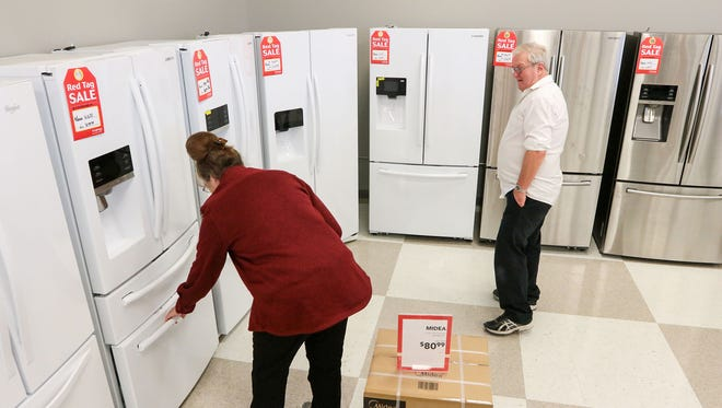 Ray and Brenda Sanders of Walhalla shop Tuesday for a refrigerator at hhgregg in Anderson.