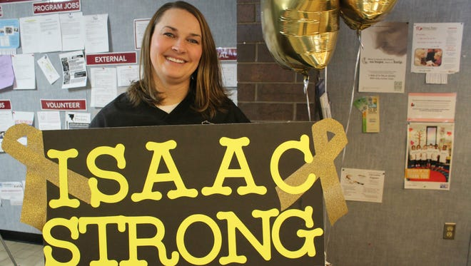 Courtney Kostuchowski, a criminal justice-corrections instructor at Mid-State Technical College, and her students hope to raise $10,000 on GoFundMe.com for Isaac Mlodik, a Stevens Point fifth-grader who was diagnosed with osteosarcoma. If they can raise the money, Kostuchowski has promised to shave her head into a yellow-dyed faux hawk.