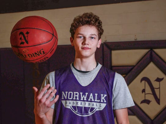 Norwalk point guard Bowen Born poses for a photo at