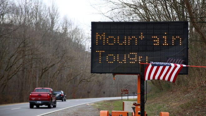 "Cars driving into  Gatlinburg are greeted with a ""Mountain Tough"" sign Dec. 9, 2016. Gatlinburg re-opened to the public today after wildfires damaged the city early last week."