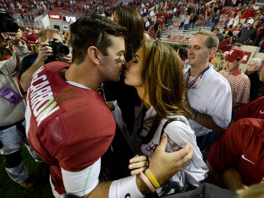 Alabama Crimson Tide quarterback A.J. McCarron (10) kisses his girlfriend Katherine Webb following their 52-0 victory over the Arkansas Razorbacks at Bryant-Denny Stadium.