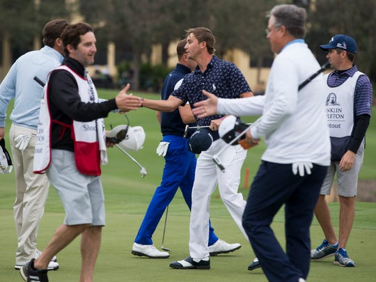Smylie Kaufman, center, shakes hands with Sean O'Hair, light blue sweater, during the second round of the Franklin Templeton Shootout at Tiburón Golf Club at The Ritz-Carlton Golf Resort Friday, Dec. 9, 2016 in Naples. Kaufman and his teammate Justin Thomas would finish the round with a score of 15-under par.