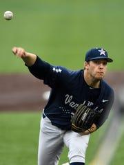 Vanderbilt pitcher Mason Hickman (44) throws in a pitch