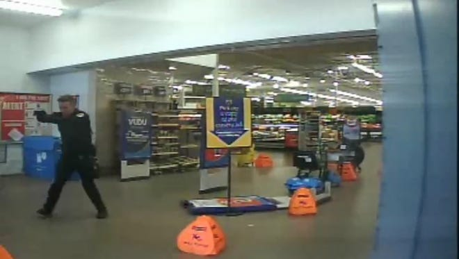 Surveillance video from a Chandler Walmart shows Chandler police Officer Daniel Colwell returning fire with a trespassing suspect.