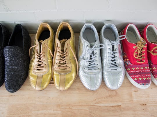 Jonathon Raley's collection of favorite shoes lined up at his home.
