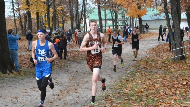 Gannon Smith of Rudyard (5) runs side-by-side with Lars Huffman (170) of Mackinaw City during the Autumn Classic in Kinross Saturday in this file photo. The Rudyard boys finished first in the Eastern UP Conference Monday, culuminating the EUPC season in Newberry.