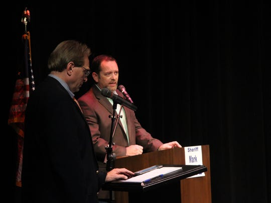 Under Sheriff Mark Cage, right, fields a question from debate host Gene Dow, left, during the debate Tuesday night at the Ocotillo Performing Arts Center in Artesia.