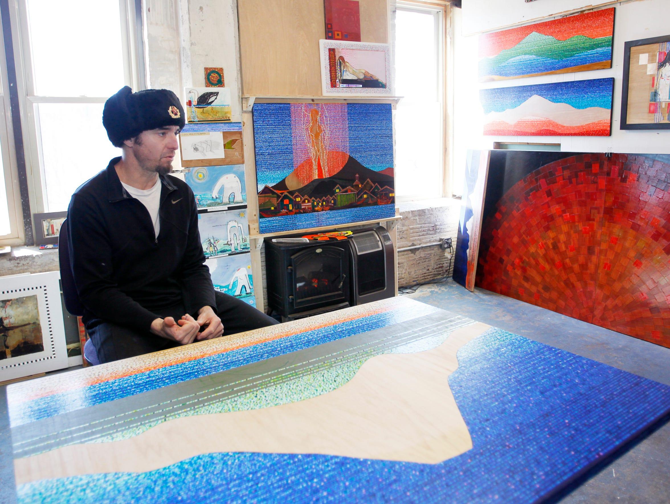 Artist Stephen Lange works in his studio in the Phil