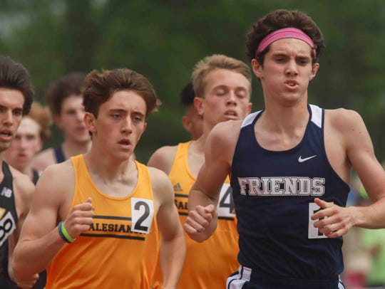 Wilmington Friends' Connor Nisbet takes the lead in the boys 1,600-meter race during the New Castle County Track and Field Championships on May 12 at the Charter School of Wilmington.