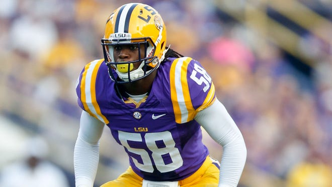LSU Tigers linebacker Tahj Jones (58) against the Kent State Golden Flashes during the first half of a game at Tiger Stadium.