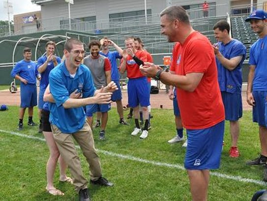 John Thompson walks on grass as Rockland Boulders manager