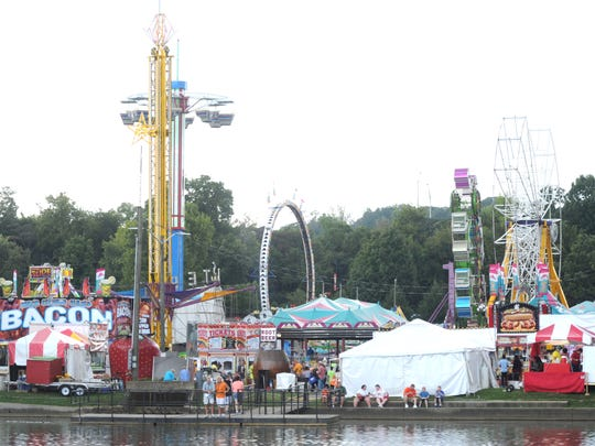 Rides and tents are set up for the Tennessee Valley Fair's opening day at Chilhowee Park on Sept. 11, 2015.