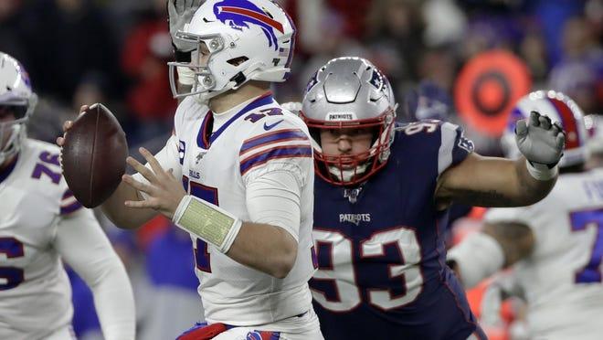 Patriots defensive tackle Lawrence Guy, right, closes in to sack Buffalo Bills quarterback Josh Allen during their game Dec. 21 in Foxboro.