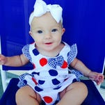 Below  is a picture of Baby Tyler Elizabeth ready for her first Fourth of July with family and friends.