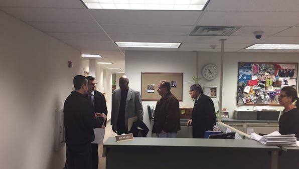 Rockland District Attorney's Office detectives discuss the seaizure of records with Ramapo attorney and Building Department personnel on Friday, March 24, 2017