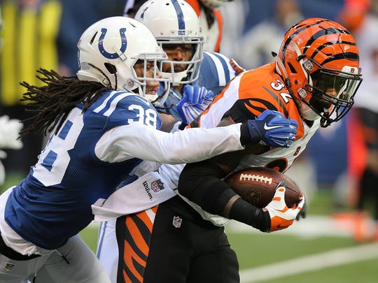 Colts safety Sergio Brown brings down Bengals running back Jeremy Hill in the second half of the game at Lucas Oil Stadium on October 19, 2014.