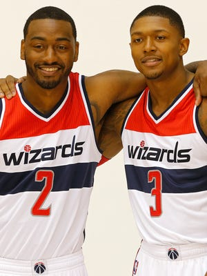 Wizards guards John Wall, left, and Bradley Beal show off their camaraderie at media day Monday.