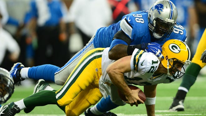 Green Bay Packers quarterback Aaron Rodgers (12) is sacked by Detroit Lions defensive tackle Nick Fairley (98) during the third quarter.