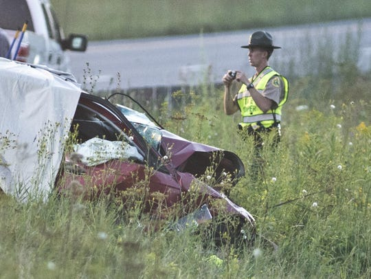 A Vermont State trooper at the scene of the fatal crash