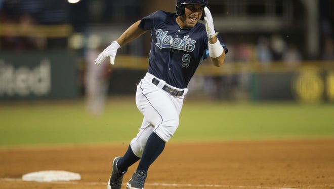 Hooks Ramon Laureano runs home to score during the fifth inning of their game against Arkansas Travelers at Whataburger Field on Monday, July 10, 2017.