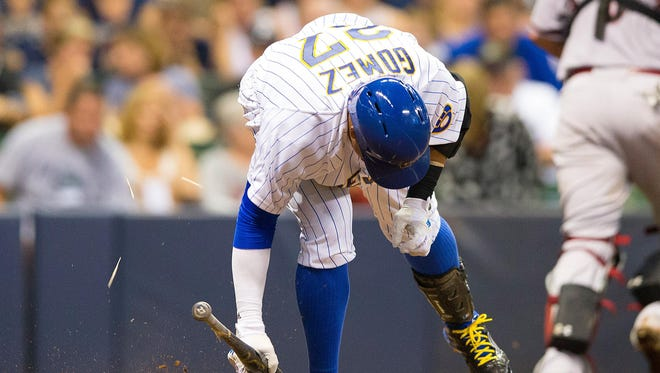 Milwaukee Brewers center fielder Carlos Gomez breaks his bat after striking out against the Arizona Diamondbacks at Miller Park.