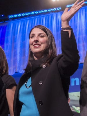 Ronna Romney-McDaniel waves to delegates at the Michigan Republican Party Convention at the Lansing Center on Feb. 21, 2015, after being nominated.