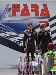 Hamilton (left) and brother Hunter Harris stand on the winner's podium at the Formula & Automobile Racing Association race in Sebring last July. They also led every lap.