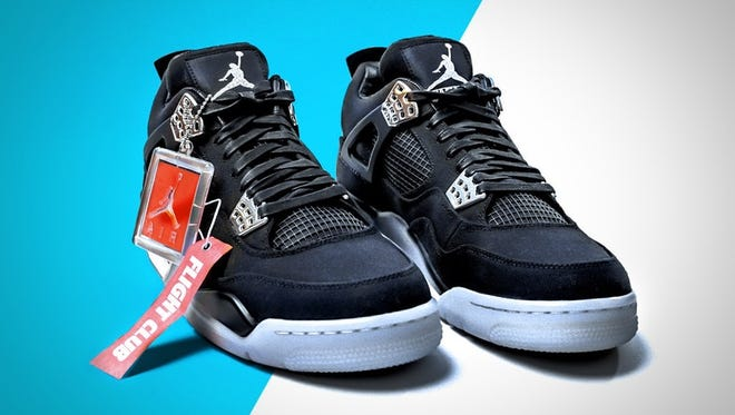These size 10, never-been-worn Carhartt® x Eminem® Air Jordan® 4  are up for charity auction.