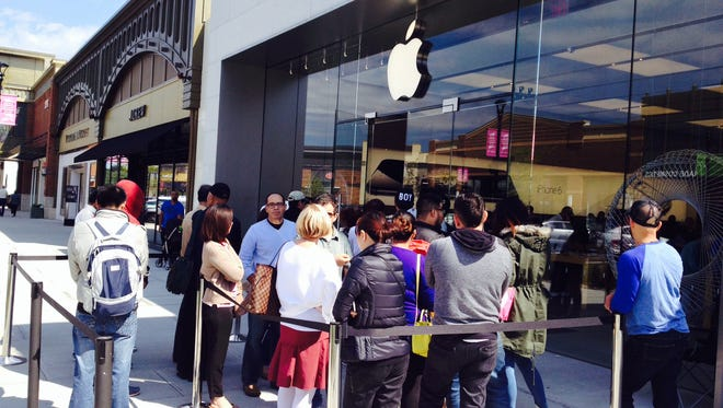 Fans of the iPhone6 line up outside the Apple store at the Shops at Nanuet on Friday, Sept. 19, 2014, the opening day for the phone. The store was packed since opening.