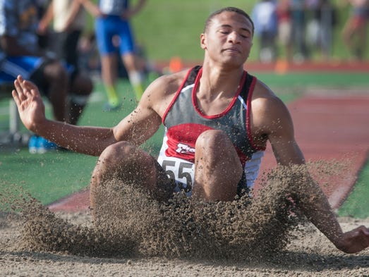 Isaiah Hartmann, Fishers, competes in the long jump during the IHSAA sectional track meet at Carmel High School, May 22, 2014.