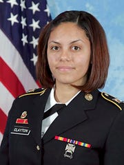 U.S. Army combat camera photographer Spc. Hilda Clayton