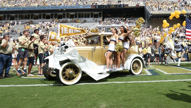 The Georgia Tech Ramblin' Wreck drives onto the field before the game against Vanderbilt.