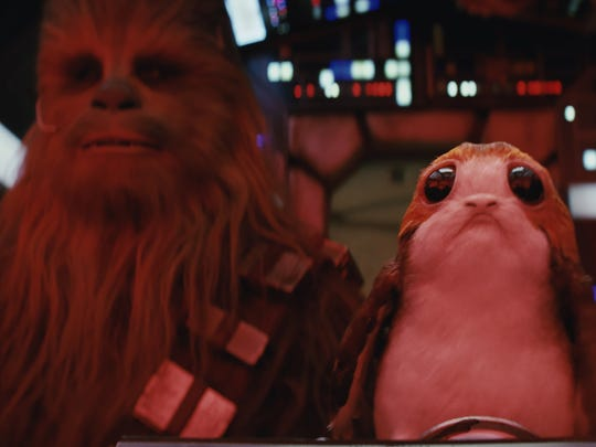 Chewbacca (Joonas Suotamo, left) shares the cockpit