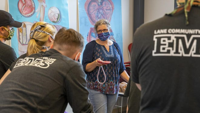 Lane Community College EMT instructor Cyndy Meno teaches a lab during spring term. The LCC Board is discussing fall reopening plans Wednesday. [Andy Nelson/The Register-Guard file] - registerguard.com