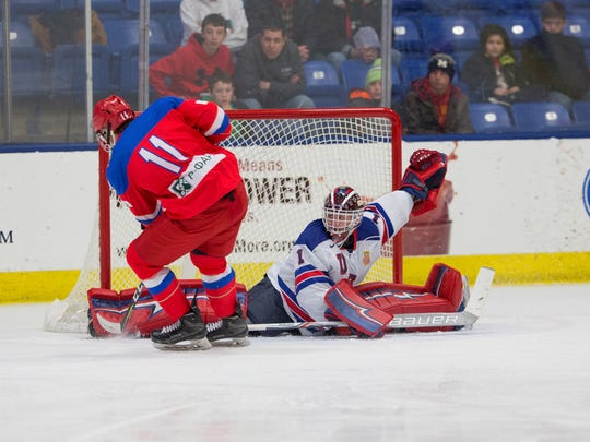 Team USA goalie Drew DeRidder (1) stretches out to stop this Russian player's scoring attempt during the Five Nations Tournament at USA Hockey Arena in February. DeRidder and his teammates now embark on a quest for gold at the U-18 worlds in Russia.