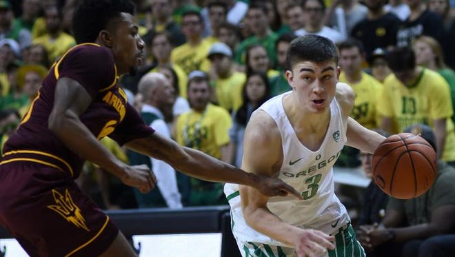 Feb 2, 2017; Eugene, OR, USA; Oregon Ducks guard Payton Pritchard (3) dribbles the ball around Arizona State Sun Devils guard Shannon Evans II (11) during the first half of the game at Matthew Knight Arena. Mandatory Credit: Godofredo Vasquez-USA TODAY Sports