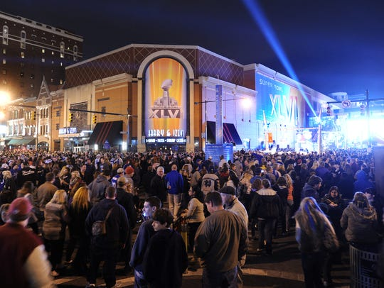A sea of Super Bowl XLVI fans and Super Bowl Village goers pack Illinois and Georgia Street Friday night downtown Indianapolis.