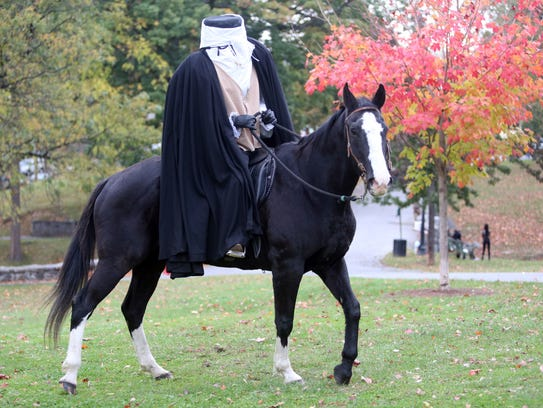 The Headless Horseman rides along Patriots Park before