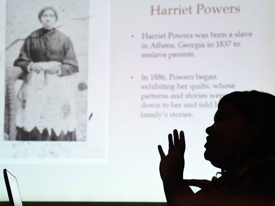 Evansville African-American Museum curator Britney Westbrook discusses quilter Harriet Powers during a lecture about African-American quilters and the Underground Railroad at the Henderson County Public Library Saturday, February 11, 2017.