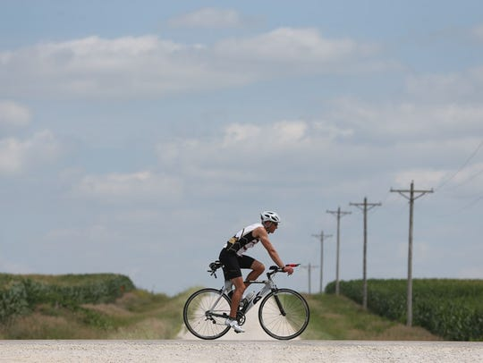 A rider rolls down a section of highway outside Greene, Iowa, in 2014.
