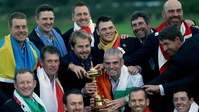 The victorious European Ryder Cup team poses after Sunday's win.
