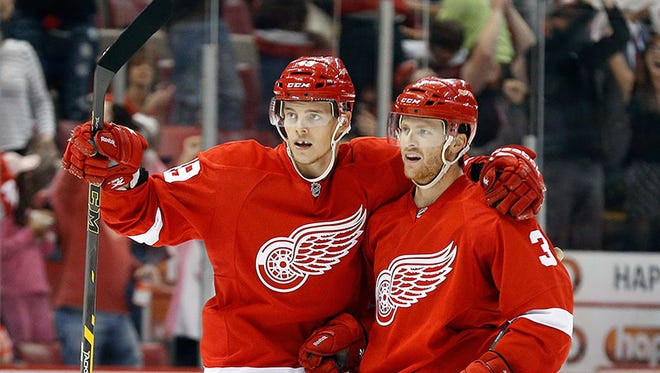 Red Wings defenseman Nick Jensen celebrates his goal against the Maple Leafs with Andrej Nestrasil, right, in the second period tonight at Joe Louis Arena.