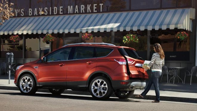Foot sensor allows hands-free hatch opening on Ford Escape crossover.