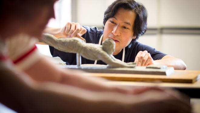 Thu., Jan. 19, 2017:  Tom Tsuchiya sculpts a small-scale Pete Rose clay model, which is part of Tsuchiya's process of creating a statue of the Hit King. Wearing one of Rose's original jerseys, Greg Hoeting, an engineer at Exact Metrology ÐÊthe company that is doing the 3-D scanning, stands in as a model for Rose's torso and arms.