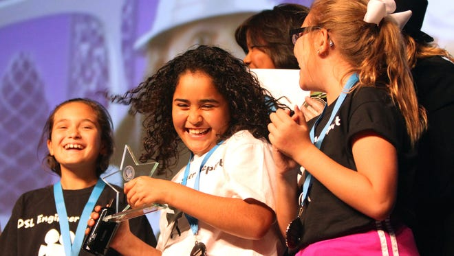 Della S. Lindley fifth-grader Azlynn Lara smiles after receiving an award during The 2016 DIGICOM Film Festival held at the Palm Springs Convention Center in Palm Springs on Tuesday, May 3, 2016.