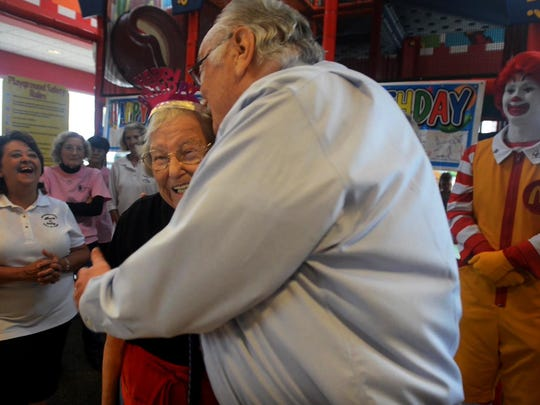 Martha Reves receives a hug from McDonald's franchise owner Fred Tillman during Reves' 95th birthday celebration Tuesday at McDonald's on North Highland Avenue. Reves has been employeed at McDonald's for over 20 years.