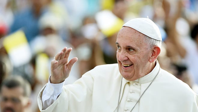 Pope Francis waves to the crowd upon his arrival in Santiago de Cuba. Santiago, the last stop on Pope Francis's Cuban tour, is known for its revolutionary history, its rum and the troubadours who have infused the Caribbean island's music with their tropical beats.