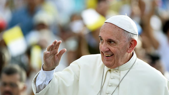 Pope Francis waves upon his arrival in Santiago de Cuba, on September 21, 2015.