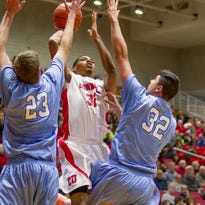 Cornell senior Shonn Miller, pictured shooting against Columbia's Cory Osetkowski, 23, and Chris McComber during their game this season at Newman Arena, will finish his college basketball career at the University of Connecticut.